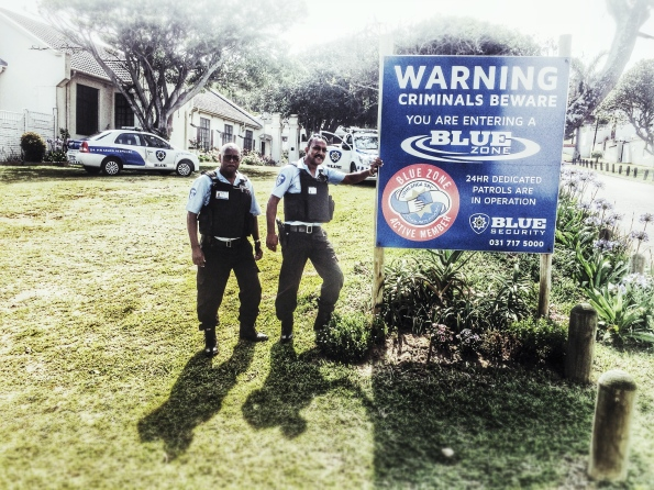 """Our local Blue security guard posing in front of the Anglican Church. He works twelve hours a day, seven days a week. """"This street corner is his home"""" states his superior wryly."""